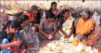 Women villagers of Kuchchaveli prepare annadanam to offer to Pada Yatra